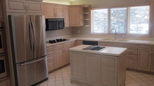 Simple-Triple-Window-without-Curtain-on-Plain-Wall-Paint-closed-Double-Sink-under-Arched-Crane-near-Small-Counter-on-Floortile-and-Refinish-Oak-Kitchen-Cabinets